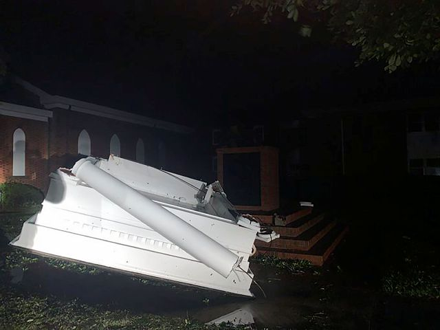 A bell tower toppled outside of Southport Baptist Church in Southport, N.C. as hurricane Isaias moved through North Carolina on Tuesday, Aug. 4, 2020. (WECT-TV via AP)