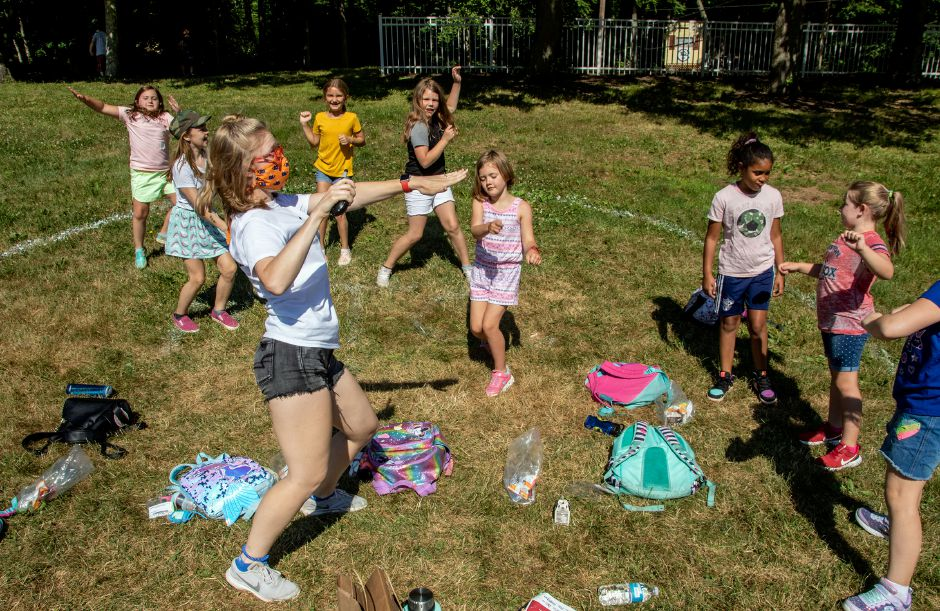 Camp counselor Lindsey Pytel dances with her Music Theater Campers as they stay in their designated area before the start of morning announcements at Meriden YMCA's Mountain Mist Day Camp on Friday, June 26, 2020. After campers arrive to camp they stay with their groups. Aaron Flaum, Record-Journal