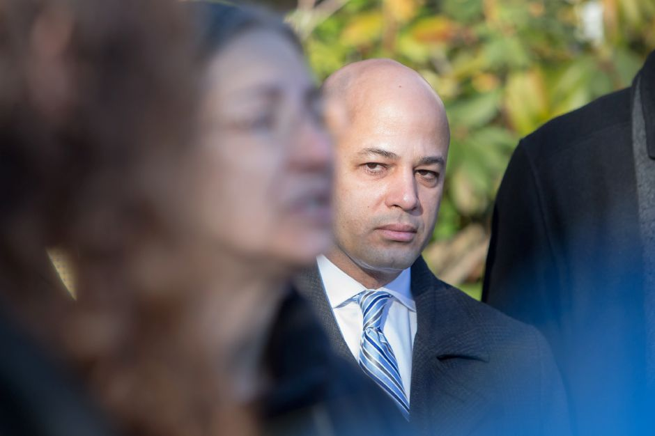 Meriden Councilman Miguel Castro listens to Debra Cohen speak out in protest of his arrest Thursday during a press conference at the Superior Court in Meriden December 27, 2018 | Justin Weekes / Special to the Record-Journal