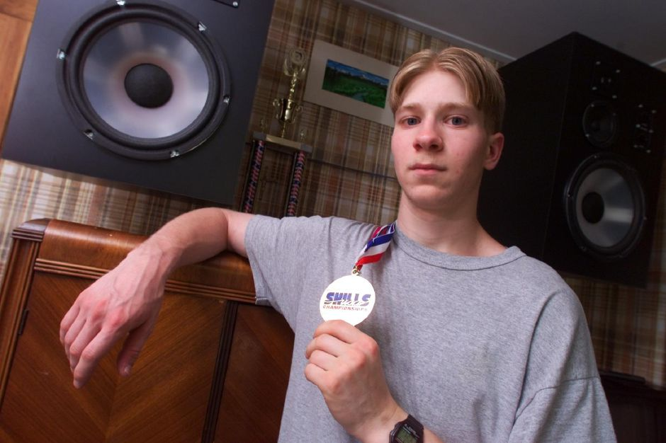 Jeff Pagini,18 holds a first place gold medal he recently won in a national electronics competition in Kansas, July 1999. Jeff graduated from Wilcox Tech last month.