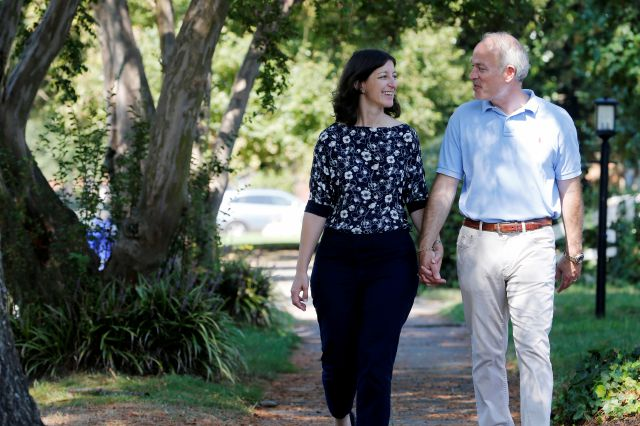 Rep. Elaine Luria, D-Va., left, walks with her husband, Robert Blondin, near her home in Norfolk, Va., Thursday, Oct. 3, 2019. Luria recently joined a group of other Congresswomen to call for the impeachment of President Trump. (AP Photo/Steve Helber)