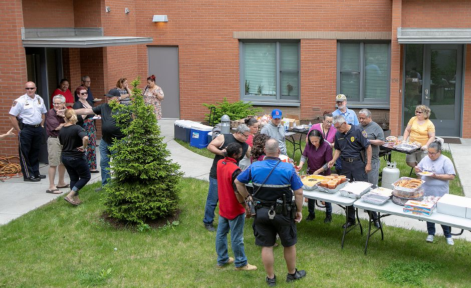 Meriden police hold a community cookout in the courtyard behind 24 Colony St. in Meriden, Fri., May 24, 2019. Downtown residents and members of the police department gathered as an ongoing effort to increase relationships between citizens and officers. Dave Zajac, Record-Journal