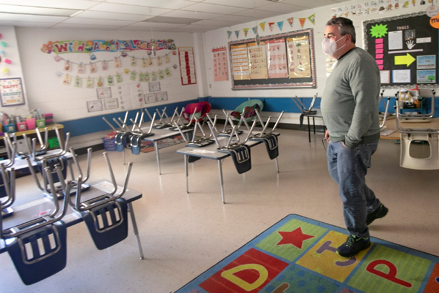FILE: Dan Coffey, principal of Casimir Pulaski Elementary School in Meriden, makes the rounds through empty classrooms, Tues., May 5, 2020. Dave Zajac, Record-Journal