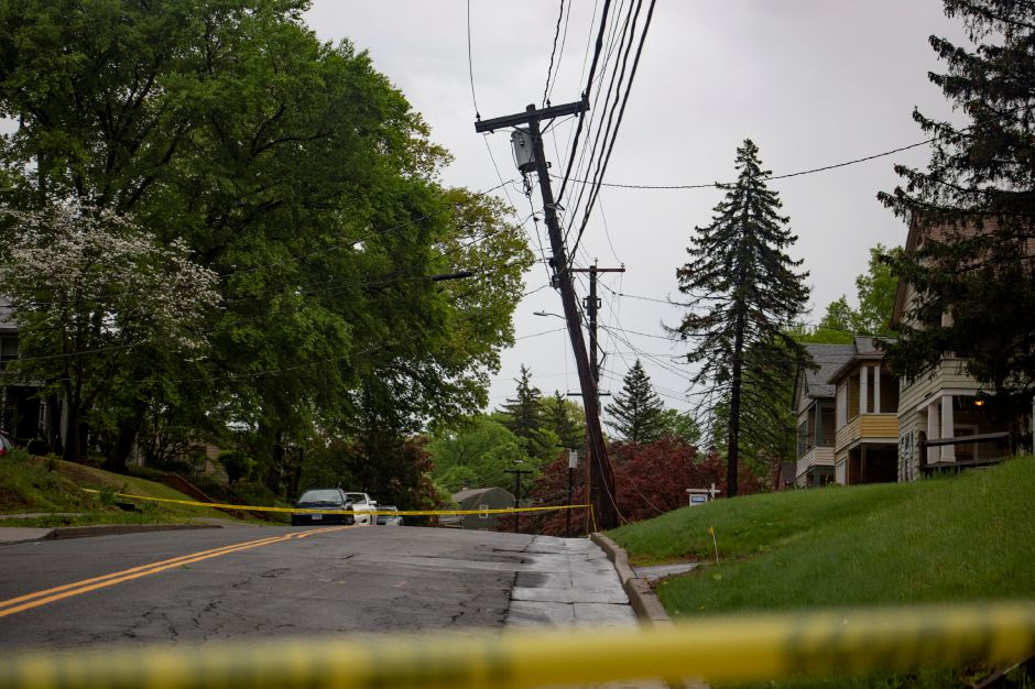 A cracked utility pole with low-hanging wires shut down Atkins Street in Meriden May 15, 2018. | Richie Rathsack, Record-Journal
