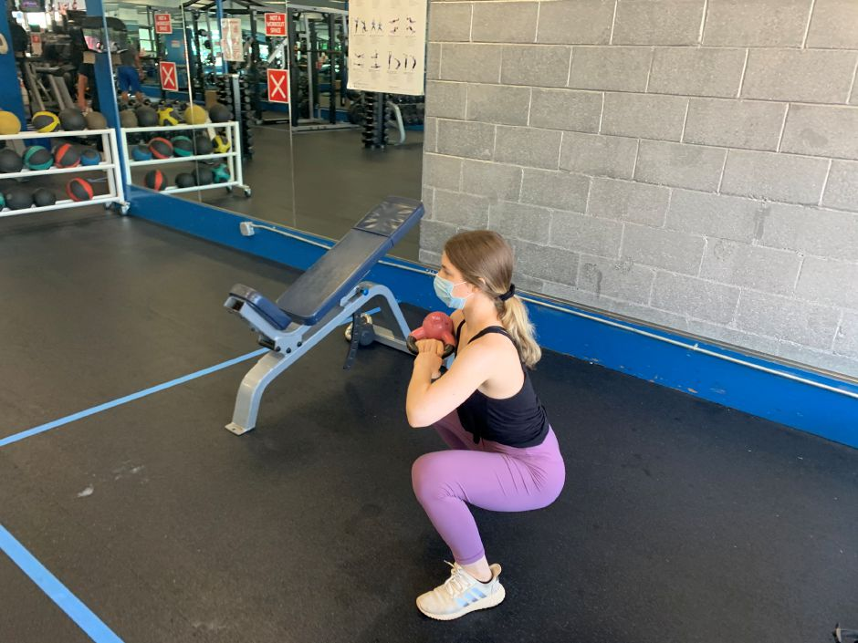 Kristen Dearborn demonstrates a one arm kettlebell squat. |Kristen Dearborn, Special to Record-Journal