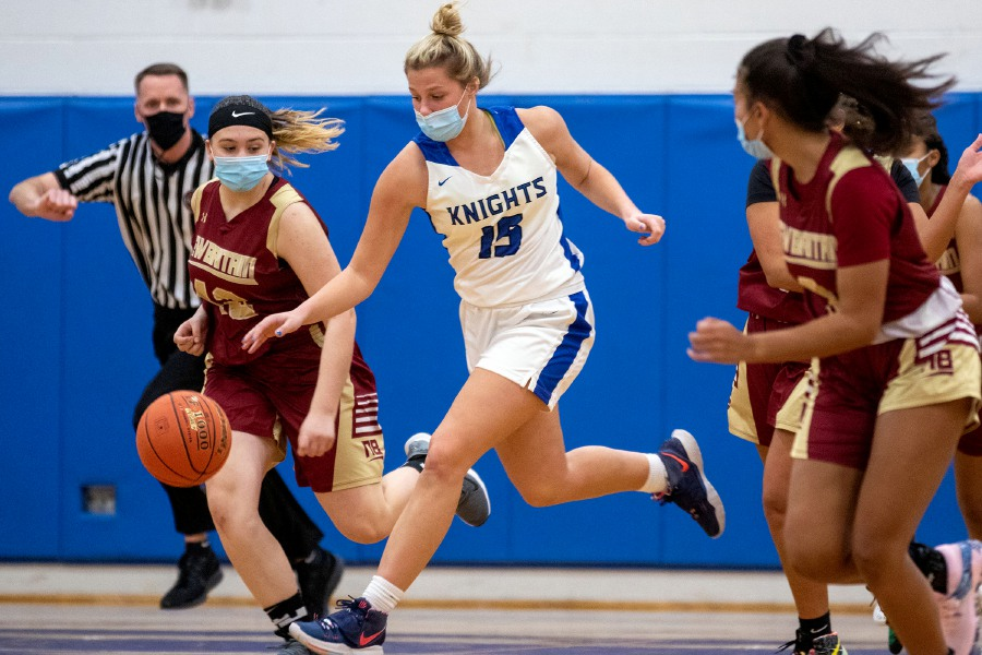 Southington's Allison Carr heads down the court chased by New Britain's Maya Kelly during Wednesday night's 67-34 victory at Southington High School. The game marked a return to action for Carr and Kelley Marshall, who suffered season-ending injuries last year. Aaron Flaum, Record-Journal