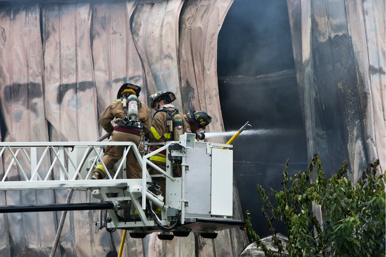 FILE PHOTO: Fire fighter spray water into the building through a hole in the structure along Atwater Street in Southington Tuesday morning, July 31, 2012. A fire broke out at the Rex Forge factory consuming a large part of the structure on the south side.(Christopher Zajac / Record-Journal)