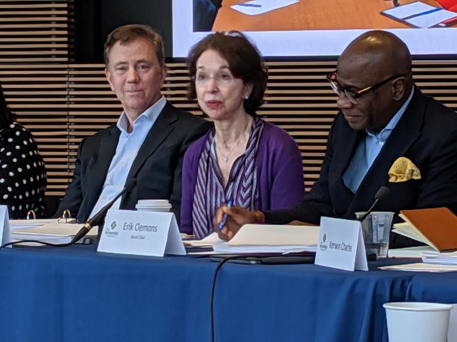 Barbara Dalio makes a point at second meeting of the Partnership for Connecticut. At left is Gov. Ned Lamont, a member of the private public partnership board, and Erik Clemons, chairman of the board. | Kathleen Megan, CT Mirror.