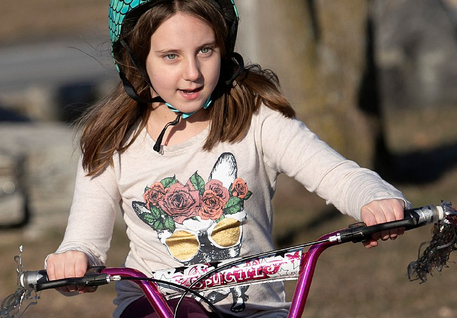 Kaylee Miglietta, 8, of Southington, rides her bike on the Farmington Canal Heritage Trail during a warm winter afternoon in Southington, Mon., Feb. 4, 2019. Dave Zajac, Record-Journal