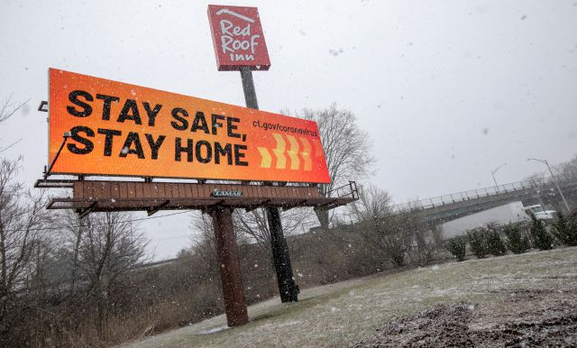 Message on an electronic billboard from ct.gov/coronavirus alerts motorists along Interstate 91 and Route 15 in Meriden. The city announced its first death from the virus on Monday. | File photo.