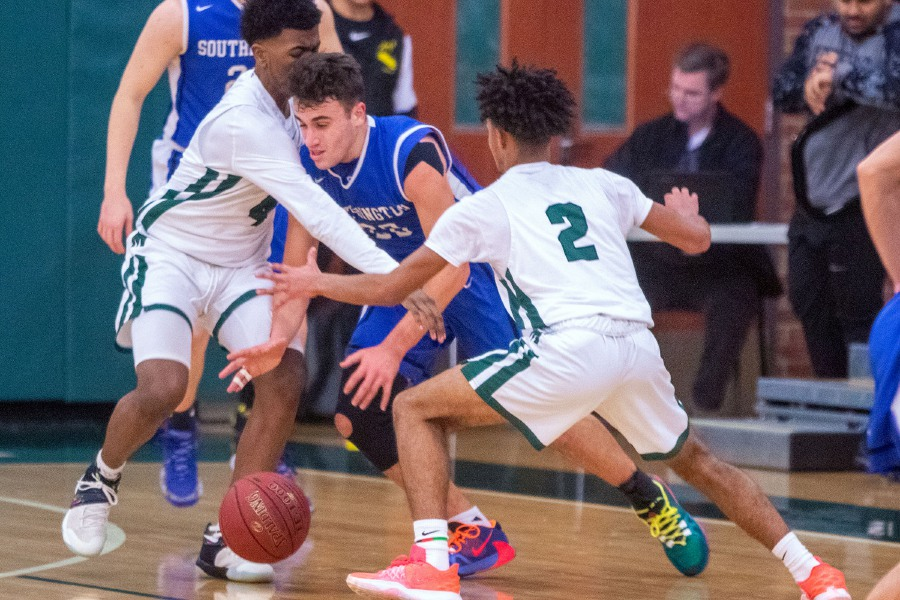 Maloney's Christian Ellison and Rashawn Wilson work on getting the ball from Southington's Jake Napoli during Thursday night's CCC interdivisional boys basketball game in Meriden. Aaron Flaum, Record-Journal