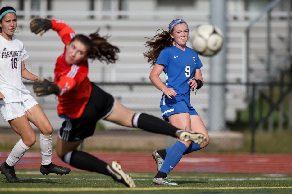 Shannon Litchfield scores a goal early in her Southington career against Farmington. Equally adept with her left foot as well as her right, Litchfield scored 45 goals and notched 22 assists for her career, which will continue at Division I Albany. Record-Journal file photo