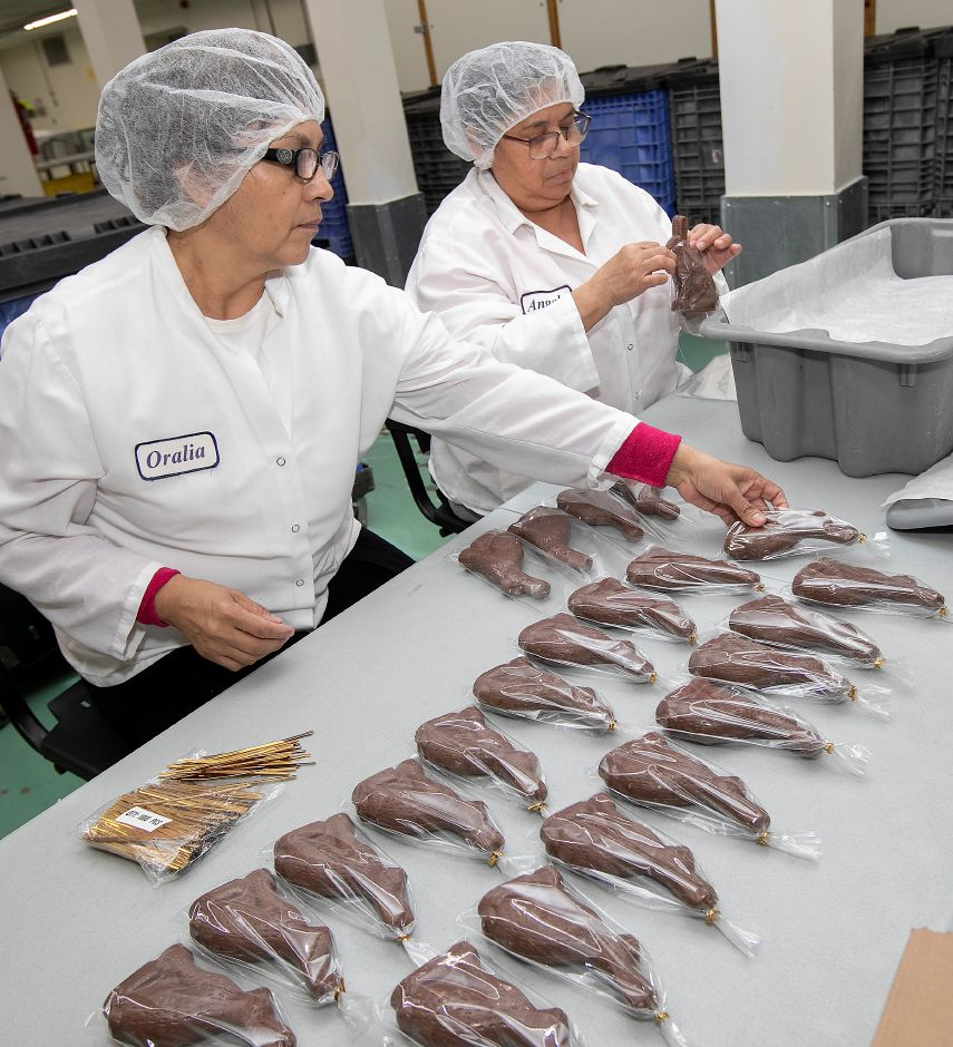 Workers Oralia Tapia, left, and Angela Duarte package 6-ounce chocolate bunnies at Thompson Chocolate, 80 S. Vine St., Meriden, Tues., Feb. 4, 2020. Thompson Chocolate is one of 18 stops on the Connecticut Chocolate Trail. Dave Zajac, Record-Journal
