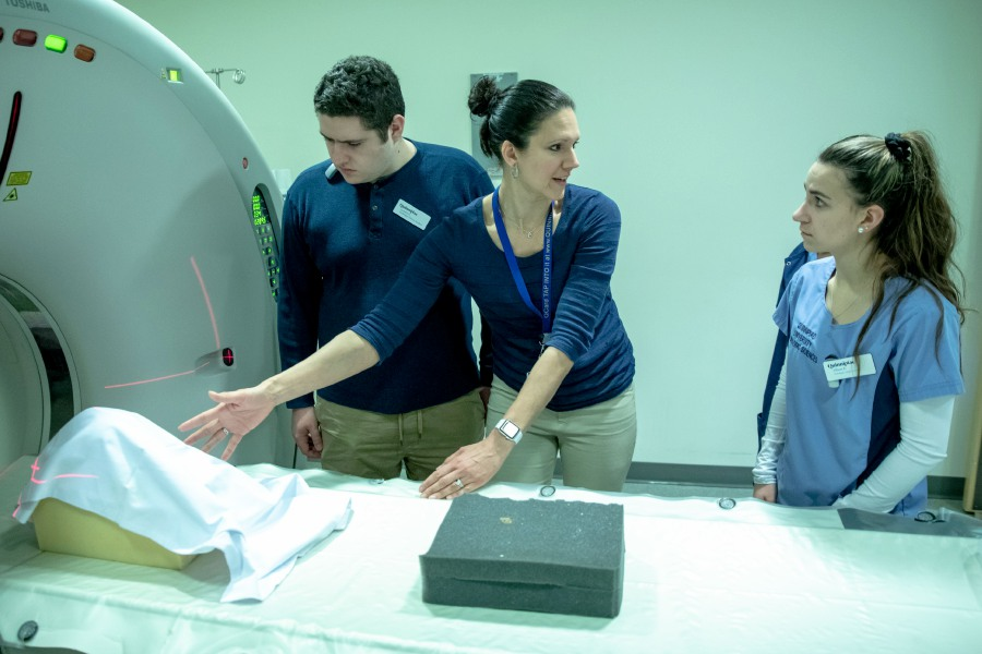 Tania Grgurich, a clinical associate professor of diagnostic imaging with Quinnipiac University, speaks to radiology students assisting with the imaging of three skeletons found beneath a Ridgefield, Connecticut home in November 2019. The skeletons, which began undergoing analysis at the university on Jan. 3, 2020, are suspected to be Revolutionary War soldiers. | Devin Leith-Yessian/Record-Journal