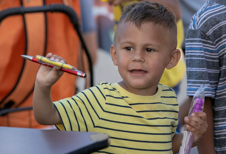 Pre-schooler Sebastian Hernandez, 3, of Meriden, smiles after receiving school supplies at the Meriden Fire Local 1148 annual Back-to-School Expo on the Meriden Green, Tues. Aug. 20, 2019. Dave Zajac, Record-Journal