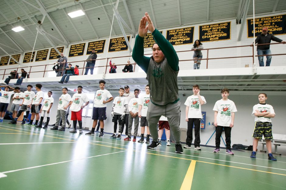 Ian Park demonstrates the long jump Saturday during the United Way NFL weekend kids camp at Choate Rosemary Hall in Wallingford March 10, 2018 | Justin Weekes / Special to the Record-Journal