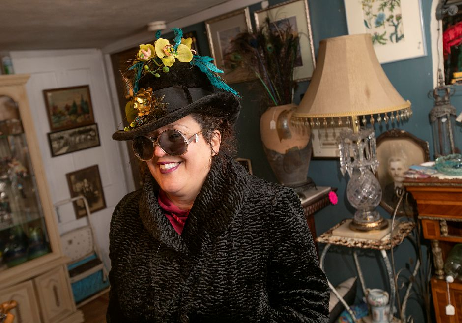 Marcy Mongillo, owner of La Vita Vintage, dons vintage clothing at the antique and vintage shop in Plantsville on Monday. Mongillo is closing the store after 22 years in downtown Southington and Plantsville.Photos by Dave Zajac, Record-Journal