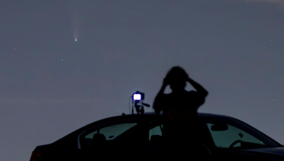 Daniel Frohman, of Middletown, shields his eyes while photographing comet NEOWISE from Lyman Orchards in Middlefield on Monday. The comet was discovered on March 27 and will not be visible again for another 6,800 years. Photos by Dave Zajac, Record-Journal