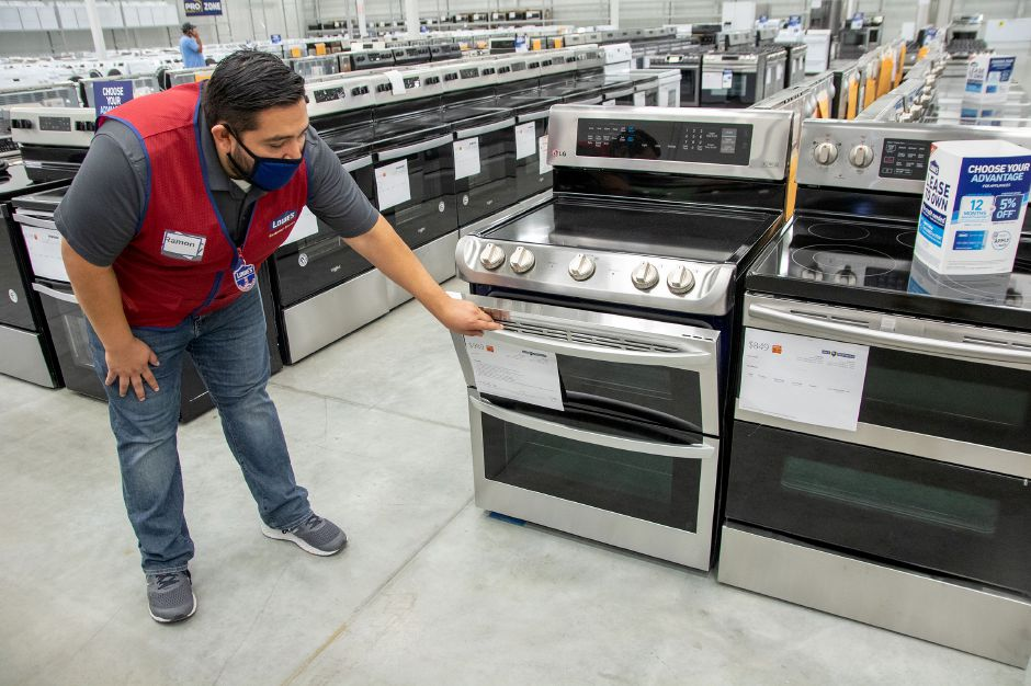 Store manager Ramon Oyarzun shows one of the many ovens that are available at the Lowe's appliance outlet center.