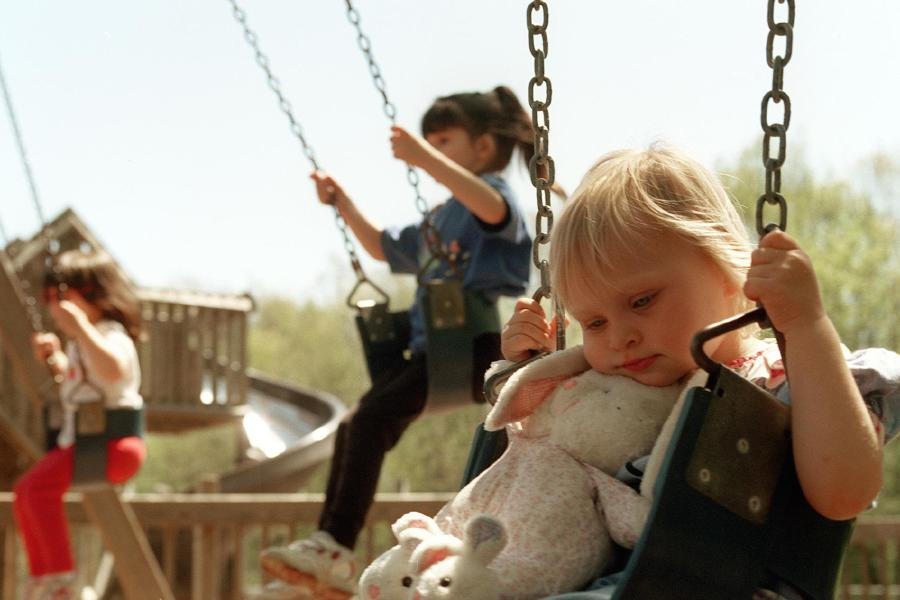 (R) Catie Moran, 22 months, of Northford rests her head on her stuffed bunny while playing on the swings at Doolittle Park in Wallingford on Wednesday afternoon May 3, 2000. In the background are (M) family friends Kristen Jalbert, 5, and Kristen Citerella, 4.