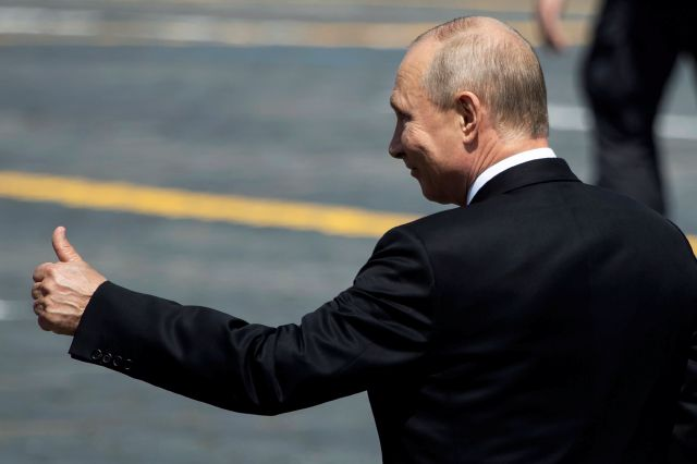 FILE - In this June 24, 2020, file photo, Russian President Vladimir Putin gestures as he leaves Red Square after the Victory Day military parade marking the 75th anniversary of the Nazi defeat in Moscow, Russia. Putin is just a step away from bringing about the constitutional changes that would allow him to extend his rule until 2036. The vote that would reset the clock on Putin's tenure in office and allow him to serve two more six-year terms is set to wrap up Wednesday, July 1, 2020....