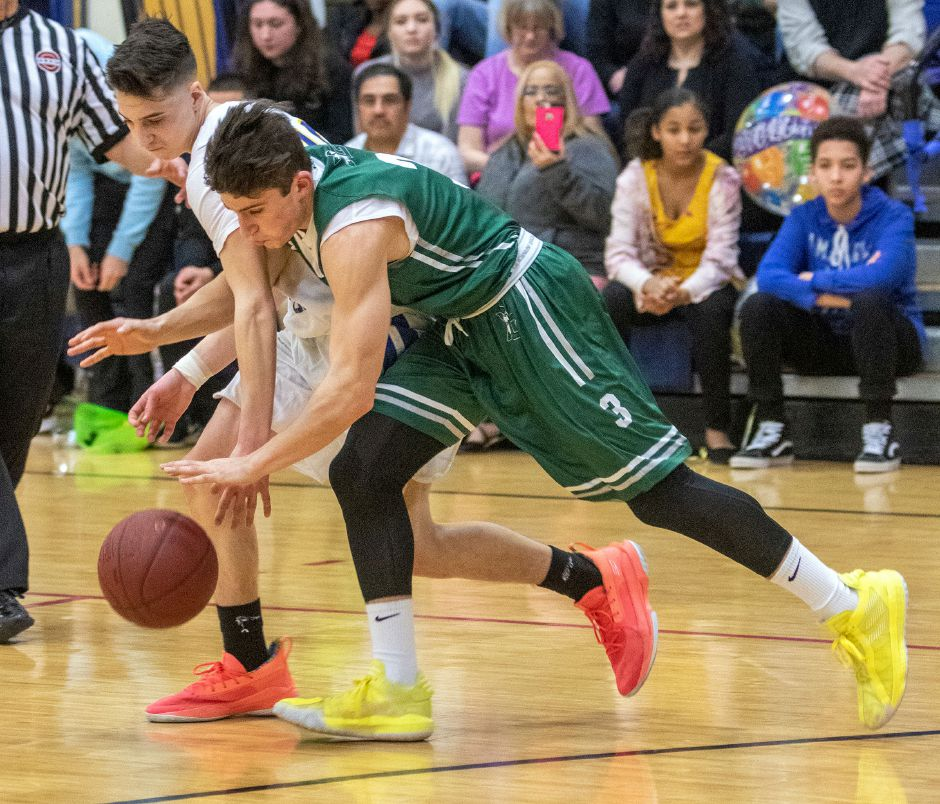 Wilcox Tech's Joe Scala and Guilford's John Petonito fight for a loose ball during the first half at Wilcox Tech High School on Tuesday, February 25, 2020. Aaron Flaum, Record-Journal