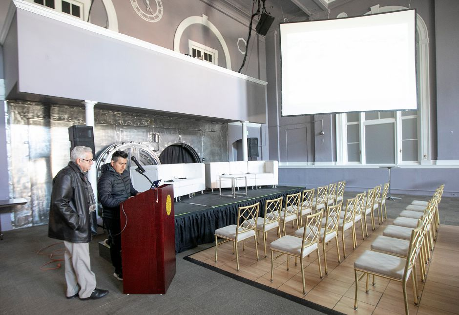 David Cooley, business recruitment specialist, left, and Angel DePaz, co-owner of the Silver City Ballroom, prepare the event space for a downtown preservation and development conference in Meriden, Wed., Nov. 13, 2019. The Making Meriden Business Center in partnership with CT Main Street Center, the city and others will host the preservation and development conference Thursday at the Silver City Ballroom, 16 Colony St. Dave Zajac, Record-Journal
