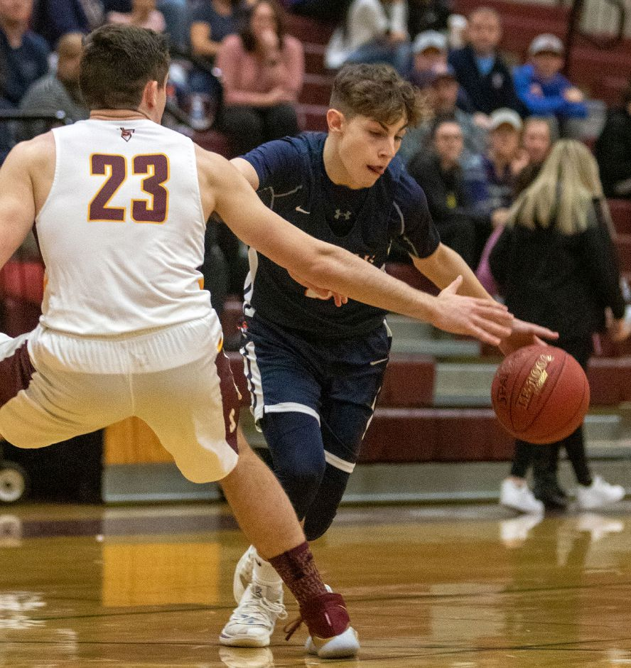 Junior point guard Ty Voisine has been the leading player this season for Lyman Hall, both has a score and play-maker. Voisine is averaging 11 points and three assists for the 1-8 Trojans. | Aaron Flaum, Record-Journal