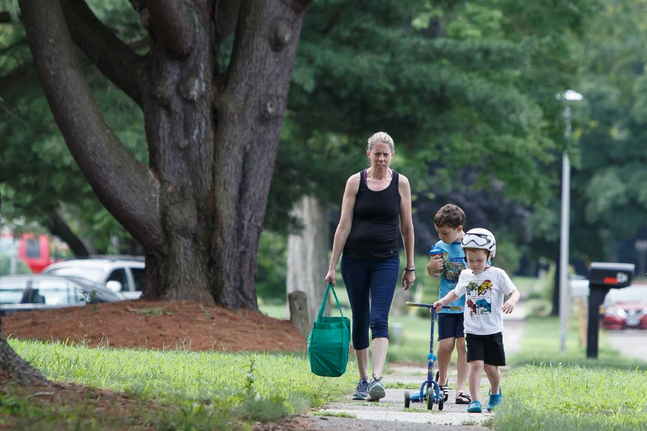 Erin Bickelhaupt of Wallingford with sons Kyle 6 and Callen 4 walk to donate books Saturday during the 6th Annual childrens book drive to benefit Read to Grow July 28, 2018 | Justin Weekes / Special to the Record-Journal