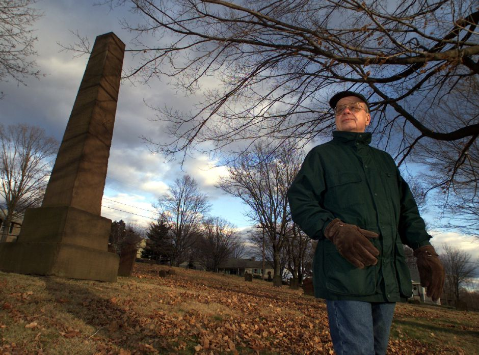 FILE PHOTO: Ken Cowing of the Meriden Historical Society walks the grounds of the Meeting House Cemetery in Meriden in 2002, where a tall brownstone shaft monument includes the name of Timothy Jerome, an ancestor of Sir Winston Churchill.