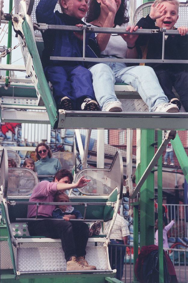 Lots of folks enjoy the old ferris wheel at the Apple Harvest Festival. Pictured bottom are Sheila Schatzman with her daughter, Kathleen, age 2 from Wallingford.