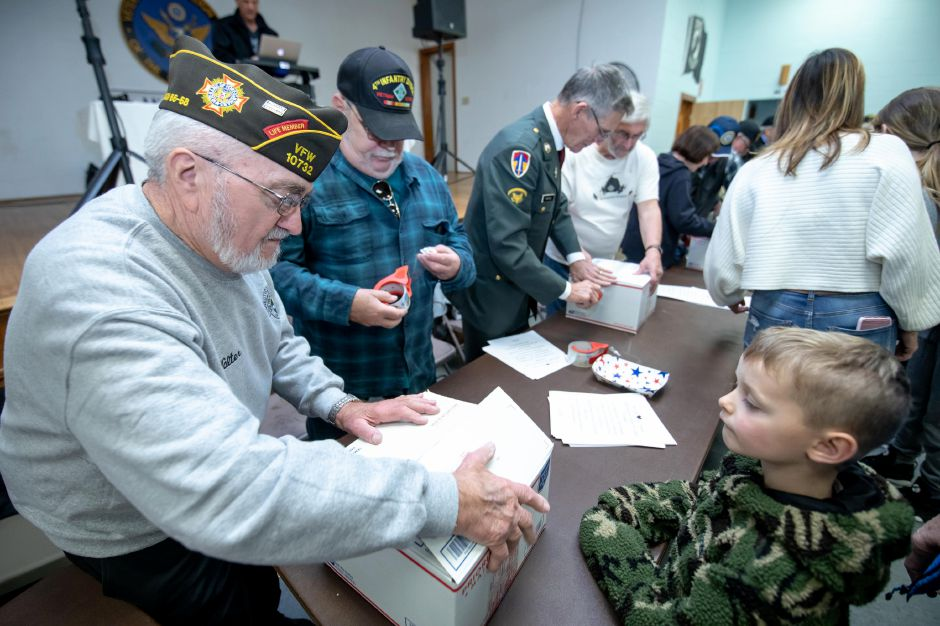 Veterans tape care packages at the New Britain VFW post for during the Hero Boxes packing day on Nov. 9, 2019. The Berlin-based non-profit sends hundreds of care packages to soldiers serving in war zones each year. | Devin Leith-Yessian/Berlin Citizen