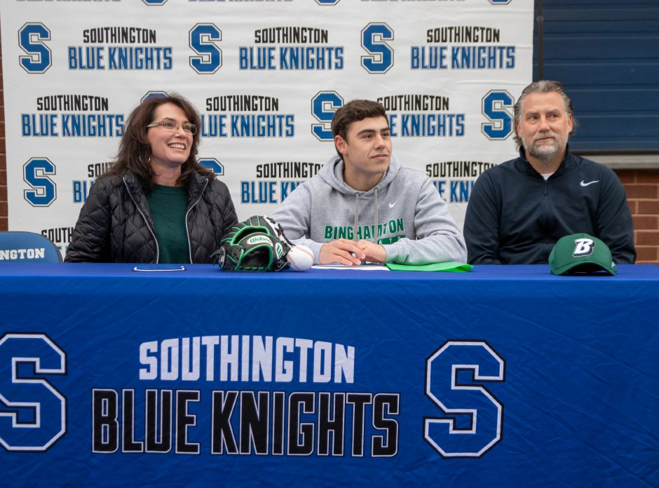 Southington's Devan Bade signs a National  Letter of Intent to play baseball at New York's Binghamton University. He was joined at the signing ceremony at Southington High School by his parents Gwen and Chris. Aaron Flaum, Record-Journal