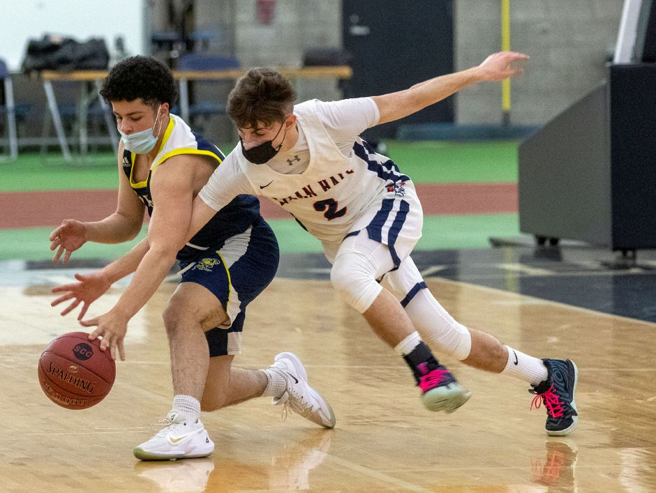 Lyman Hall's Ty Voisine looks to steal the ball from East Haven's Devin Guliani-Santiago during the first half of Friday's SCC Divison II championship game at the Floyd Little Athletic Center. Voisine was named the tournament MVP. Aaron Flaum, Record-Journal