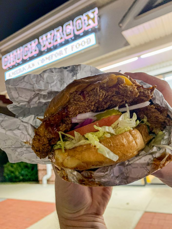 From Chuck Wagon – The Nashville Chicken sandwich features crispy barbecue smothered chicken breast, lettuce, tomato and cheddar cheese. Onion and pickles were added to the sandwich. |Lindsay Pytel, special to Record-Journal