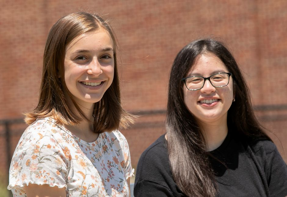 "Maloney High School students Emma Burns, 17, left, and Kelly Tran, 17, Thurs., Jun. 4, 2020. Tran's ""My Purpose, My Actions, My Life"" won best essay and Burns' 'My Biggest Fear' was the school's top speech in the 128th Annual Hicks Essay & Speech Contest. Dave Zajac, Record-Journal"