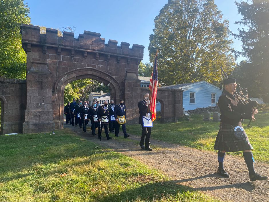 Members of Meridian Lodge No. 77 formally enter East Cemetery in Meriden for a ceremony on Saturday morning. | Seak Krofssik, Record-Journal