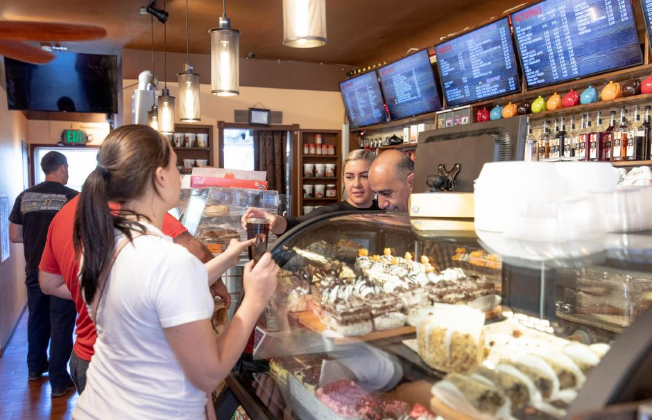 Ani Hovhannisyan serves customers at Cafe Busy Bean on August 12, 2019, after the cafe had its ribbon cutting ceremony. Owner Tigran Hovhannisyan said the cafe, which serves coffee, tea, ice cream, bagel, pastries and crepes, has grown to become a destination in town. | Devin Leith-Yessian/Berlin Citizen
