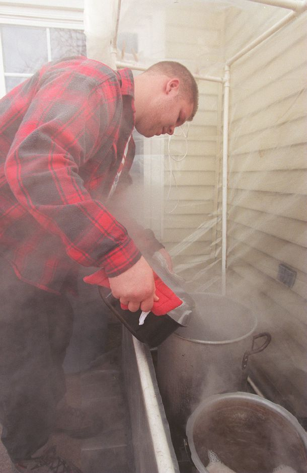 RJ file photo - Tim Doehr pours heated sap into a pot in the backyard of his parents
