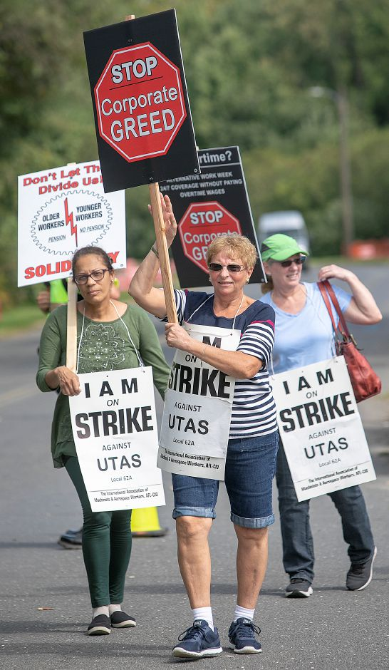 Employees of UTC Aerospace Systems, left to right, Arlinda DeBrito, of Waterbury, Anna D