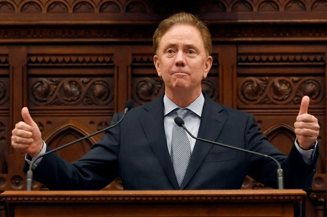 Connecticut Gov. Ned Lamont delivers the State of the State during opening session at the State Capitol, Wednesday, Feb. 5, 2020, in Hartford, Conn. (AP Photo/Jessica Hill)