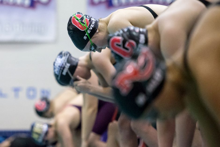 Julia Stevens and the Cheshire girls swim team improved to 8-0 and won their 63rd consecutive dual meet with Tuesday's victory over North Haven at Cheshire Community Pool. | Justin Weekes / Special to the Record-Journal