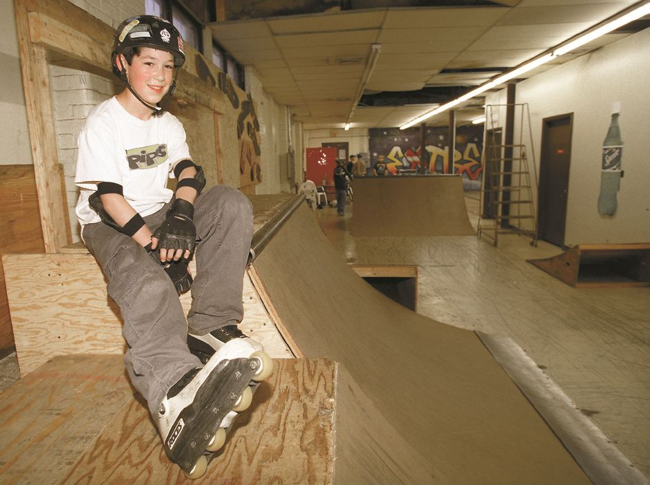 RJ file photo - Branford resident Ronnie M. DeLucia, 12, takes a break at Wallingford