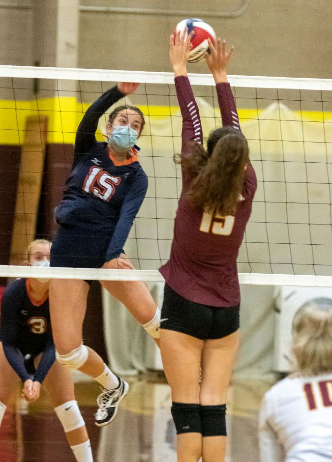 Lyman Hall's Macenzie Regan tries to get the ball past Sheehan's Colleen Kelley at Sheehan High School in Wallingford on Friday. The Trojans won by game scores of 25-21, 25-19, 20-25 and 25-22.