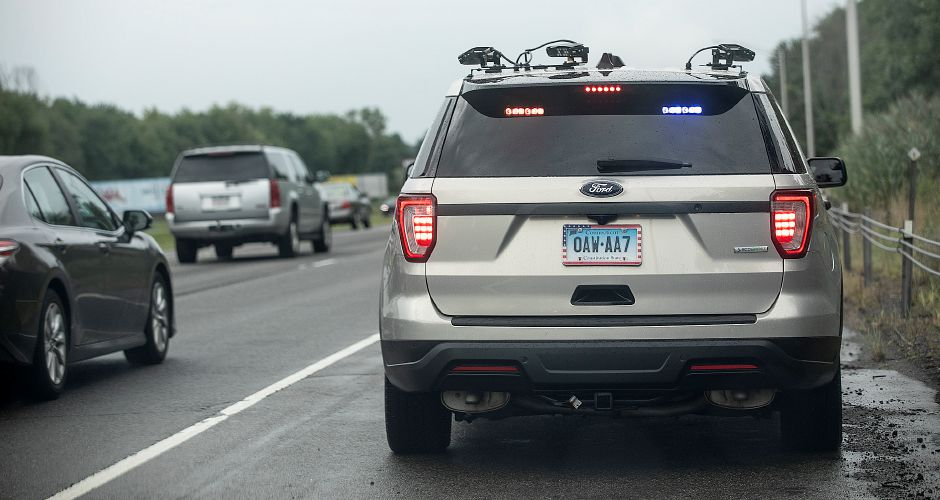 State Trooper Joshua McElroy waits for an alert from license plate readers scanning passing motorists on Interstate 91 in Meriden, Fri., Aug. 23, 2019. Dave Zajac, Record-Journal
