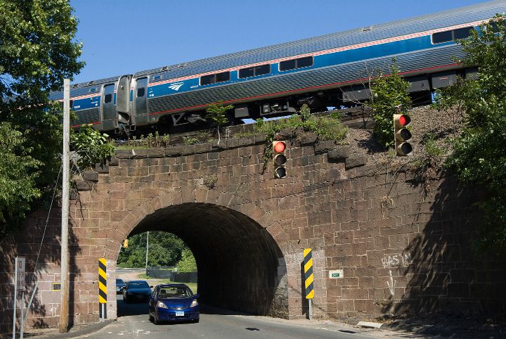 FILE: An Amtrak train passes over the tunnel near the intersection of Old Colony Road and Main Street in Wallingford in 2016. | Dave Zajac, Record-Journal