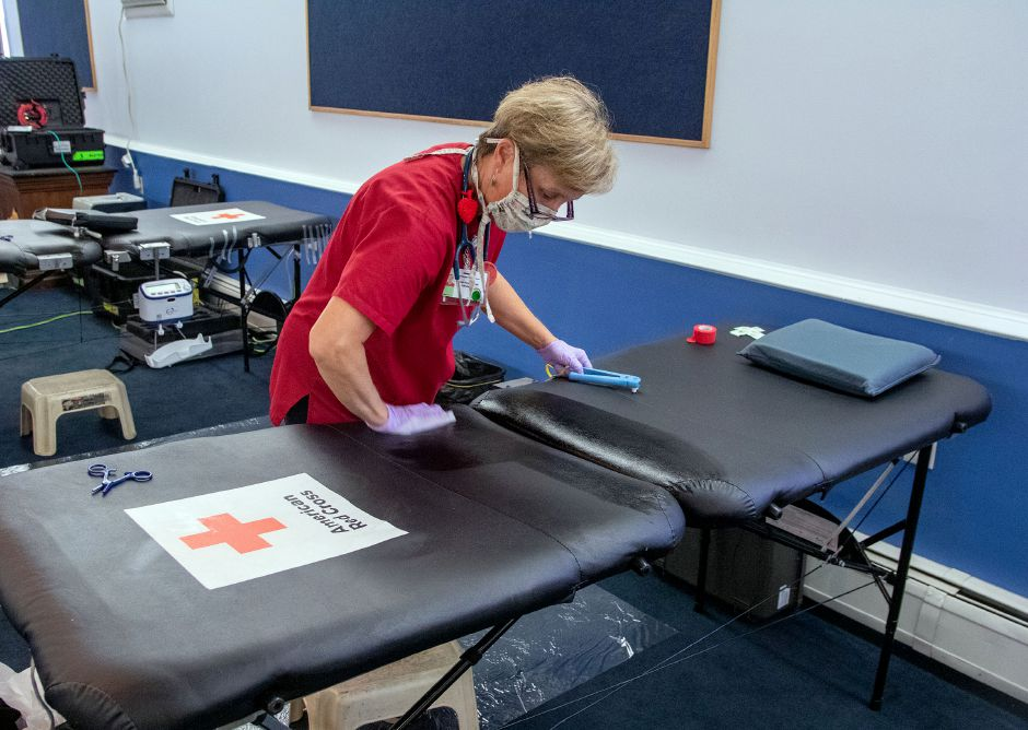 American Red Cross's Barbara Kamianowski wipes down a table after a donor gave blood during a blood drive at the Cheshire Masonic Temple Lodge in Cheshire on Friday, September 11, 2020. Aaron Flaum, Record-Journal