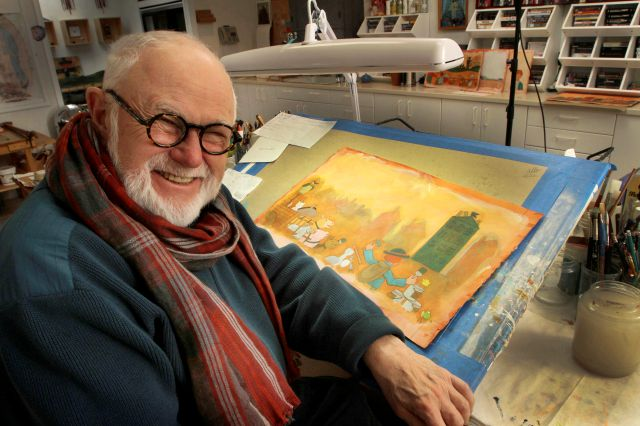 In this photo taken Sunday Dec. 1, 2013, Tomie dePaola poses with his artwork in his studio in New London, N.H. The beloved children