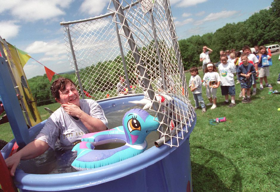 Dolores Mestuzzi, a first grade teacher at Rock Hill Elementary School, wipes water from her eyes after taking the plunge in tthe dunking booth , one of the main attractions at the school