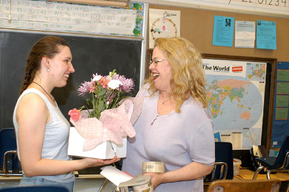 North Center Elementary School first grade teacher Linda Wrobel gets a surprise visit and flowers from Anita Holtz, who
